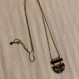 Faux marble necklace with gold colored chain